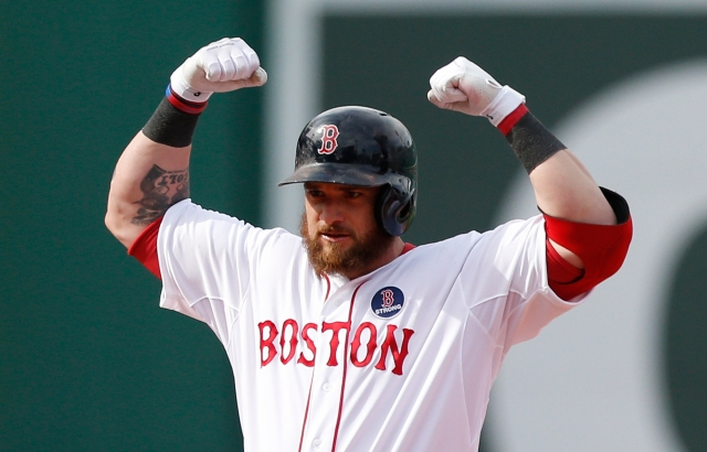 Boston Red Sox's Jonny Gomes flexes after hitting a double in the eighth inning of a baseball game against the Kansas City Royals in Boston, Saturday, April 20, 2013. (AP Photo/Michael Dwyer)